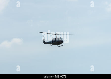 BERLIN, GERMANY - JUNE 03, 2016: Demonstration flight of military helicopter Bell UH-1 Iroquois. German Army. Exhibition - Stock Photo