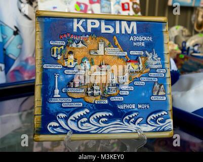 Sevastopol, Russia - November 14, 2015: Souvenir plate mural with the image of the Crimean peninsula - Stock Photo