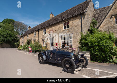 A classic 1927 Bugatti T37A sports car parked in front of The Old Post Office at Guiting Power, Gloucestershire, - Stock Photo