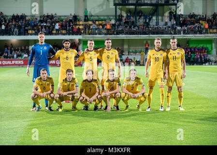 Welsh football team line up against Moldova in Chisnau - Stock Photo