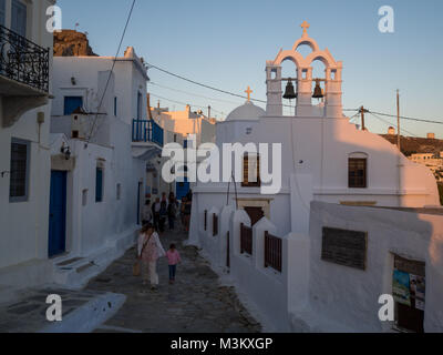 Amorgos Greece-August 1 ,2017.people coming out of a Church in chora Amorgos - Stock Photo