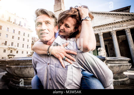 Senior couple of tourist on vacation in Rome - Stock Photo