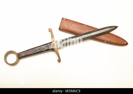 Old  dagger with a wooden sheath to carry the weapon isolated on a white background with copy space - Stock Photo