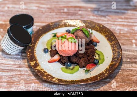 Chocolate brownie with gelato ice cream and fruit - Stock Photo