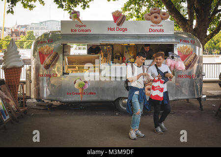 London (UK) - August 2017. Street ice cream caravan on the South Bank with tourists. Landscape format. - Stock Photo