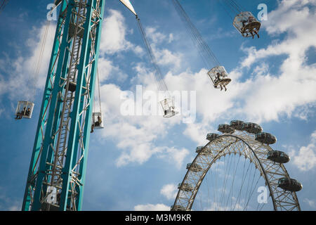 London (UK) - August 2017. Chair swing ride and the London Eye in South Bank near the Royal Festival hall. Landscape - Stock Photo
