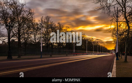 Lights on The Mall at sunset; Buckingham Palace in the background, London, UK - Stock Photo