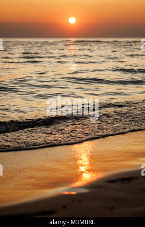 Scenic view of a summer sunset on the Ionian sea near Gallipoli, a town in the Apulian region (Italy). Portrait - Stock Photo