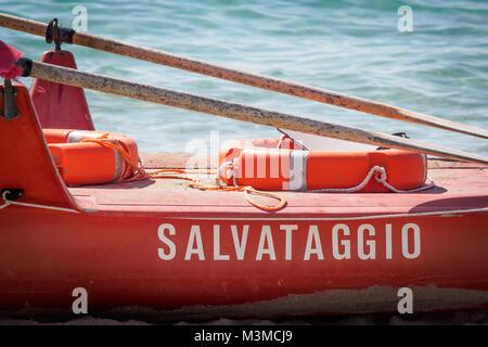 Gallipoli (Italy), August 2017. A lifeguard rowing catamaran on a beach near the seaside town of Gallipoli in Apulia. - Stock Photo