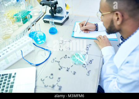 Middle-Eastern Scientist Working in Lab - Stock Photo