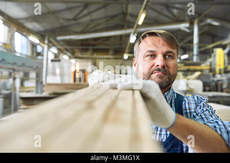 Mature Man Working in Joinery Warehouse - Stock Photo
