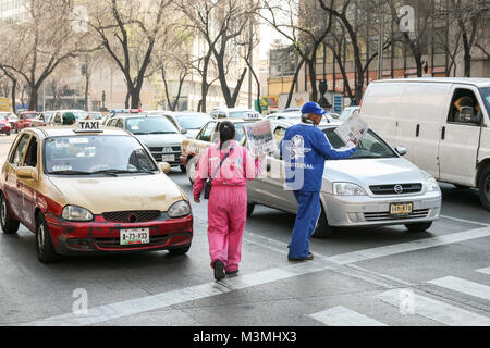 Mexico city, Mexico - MArch 3d, 2012: People sell fresh newspapers early in the morning to a car drivers on a crosswalk - Stock Photo