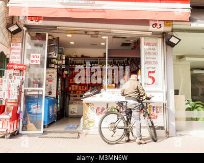 Tel Aviv, Israel. Adult man buying a cup of coffee in fast food kiosk at the early morning. Israel, Tel Aviv, Ben - Stock Photo