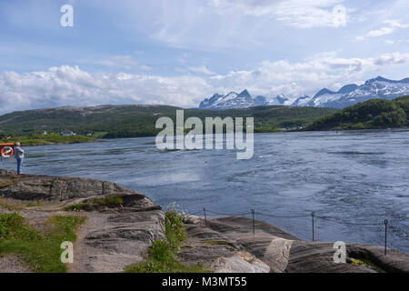 Tourist looking the Saltstraumen  a small strait with one of the strongest tidal currents in the world, Nordland - Stock Photo