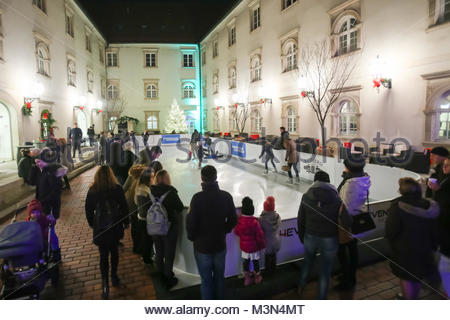 ZAGREB, CROATIA - DECEMBER 1th, 2016: Advent time in city center of Zagreb, Croatia. People ice skating at the synthethic - Stock Photo