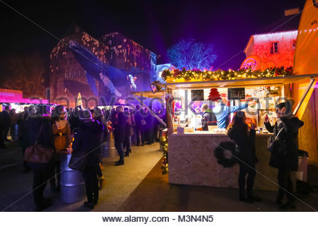 ZAGREB, CROATIA - DECEMBER 1th, 2016: Advent time in city center of Zagreb, Croatia. People drinking and eating - Stock Photo