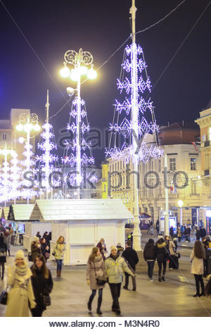 ZAGREB, CROATIA - DECEMBER 1th, 2016: Advent time in city center of Zagreb, Croatia. People walking on ornated central - Stock Photo