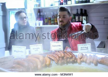 ZAGREB, CROATIA - DECEMBER 1th, 2016 : Advent time in city center of Zagreb, Croatia. Man selling popular fast food, - Stock Photo