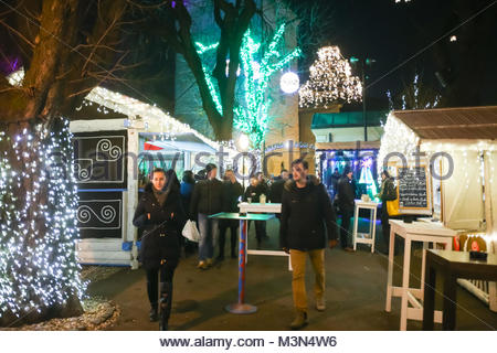 ZAGREB, CROATIA - DECEMBER 1th, 2016: Advent time in city center of Zagreb, Croatia. People sightseeing the food - Stock Photo