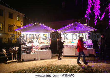 ZAGREB, CROATIA - DECEMBER 1th, 2016: Advent time in city center of Zagreb, Croatia. People passing by the souvenir - Stock Photo
