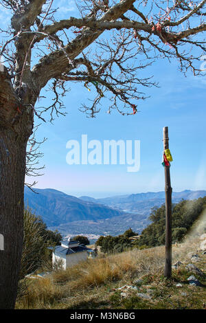Tibetan prayer flags on a stick at O Sel Ling - Centro de Retiros - Las Alpujarras, Andalusia, Spain - Stock Photo