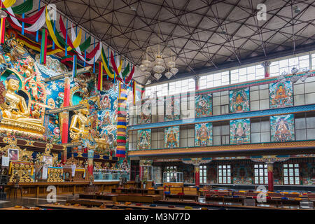 Coorg, India - October 29, 2013: Inside Padmasambhava Vihara of Namdroling Buddhist Monastery. Right side with wall - Stock Photo