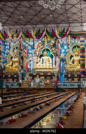 Coorg, India - October 29, 2013: Inside Padmasambhava Vihara of Namdroling Buddhist Monastery. The golden statues - Stock Photo