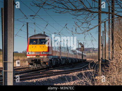 A southbound Virgin train on the East Coast main line near Alnmouth, Northumberland, North East England, on a fine - Stock Photo