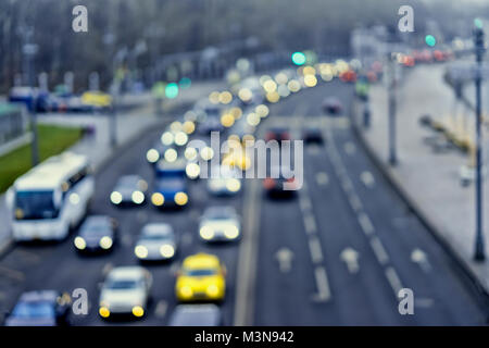 Auto, city street lights and traffic jams, taxi. Abstract toned blurred bright background of urban street evening traffic with bokeh lights. Modern backdrop