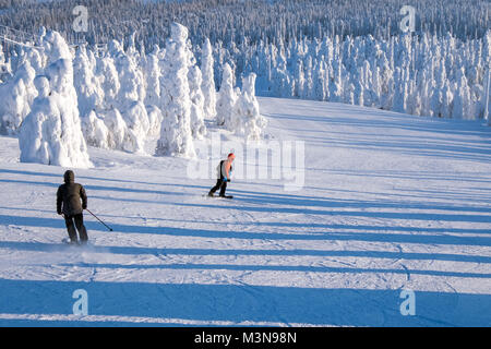 Skiers on piste atThe ski resort of Ruka in Finland - Stock Photo