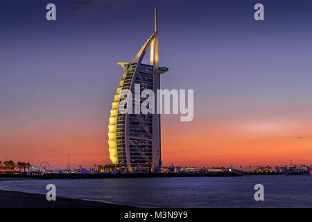 Dubai, United Arab Emirates - Jan 10, 2018. Sunset view of Burj Al Arab hotel on Jumeirah beach in Dubai, United - Stock Photo