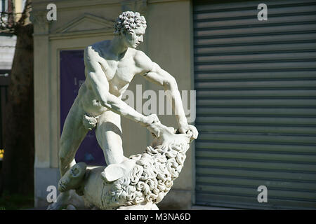 Ercole against lion - Statue in public garden of Naples, Italy - Stock Photo