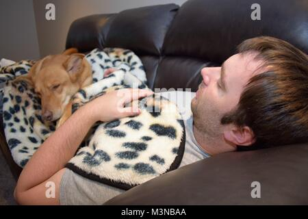 Sick day off with doggie - Stock Photo
