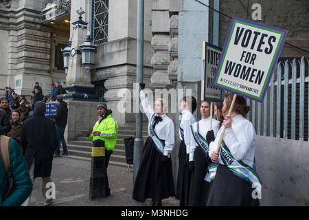 Suffragettes outside Waterloo station in 2018 looking for votes for women through deeds not words - Stock Photo