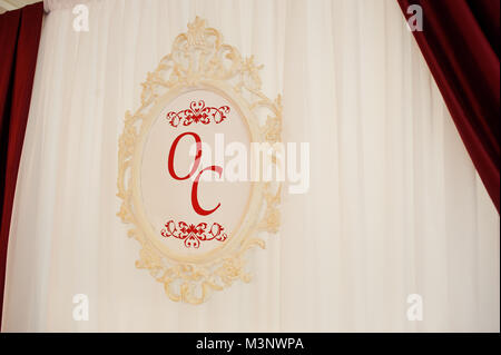 Letters of wedding couple's first names on the board hangin on the curtains. - Stock Photo