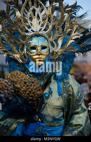Man wearing a costume for the Carnival of Venice 2018. Piazza San Marco, Venice, Italy. February 4, 2018. - Stock Photo