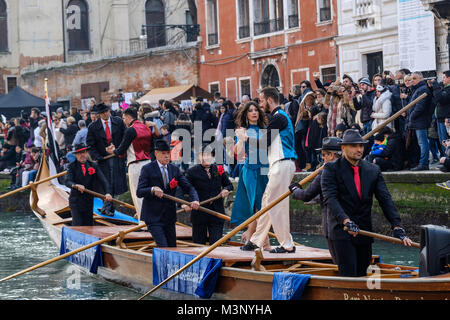 Tango dancers in the water parade of Venice Carnival 2018. Venice, Italy. January 28, 2018. - Stock Photo