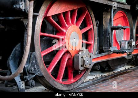 old steam locomotive wheel closeup - old transport technology - - Stock Photo