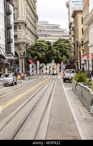 SAN FRANCISCO Ca. - JUNE 16: Passengers ride in a cable car  JUNE 16, 2015 in San Francisco. It is the most popular - Stock Photo