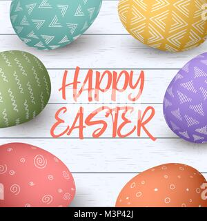 Happy Easter eggs frame with text. Colorful easter eggs on white wooden background. - Stock Photo