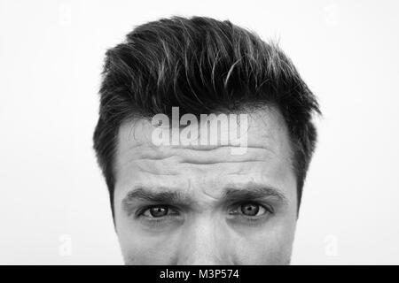 half face portrait of caucasian man with serious depression in monochrome black and white style. - Stock Photo