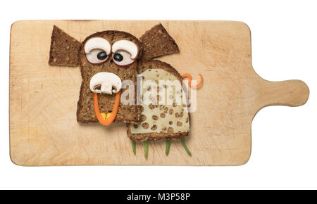 Pig made with black bread on cutting board - Stock Photo