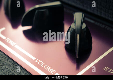 Retro guitar amplifier close up shot, volume set to maximum - Stock Photo