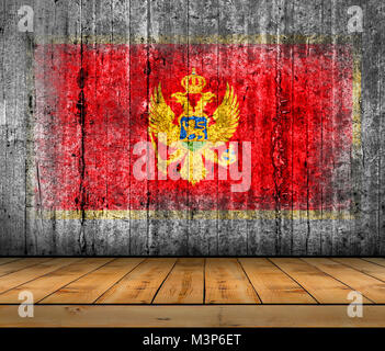 Montenegro flag painted on background texture gray concrete with wooden floor - Stock Photo