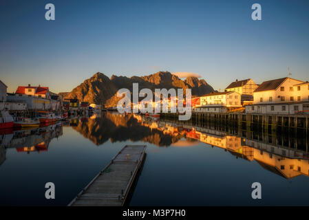 Sunset at Henningsvaer on Lofoten islands - Stock Photo