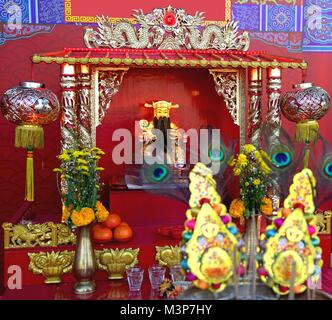 Cai Shen, Chinese God of wealth or  God of fortune statue in Chinese temple - Stock Photo