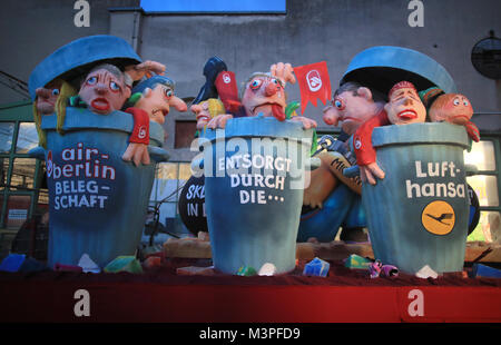 A political caricature float depicting the 'Air Berlin takeover of Lufthansa' is prepared for the Rosenmontag (Shrove - Stock Photo