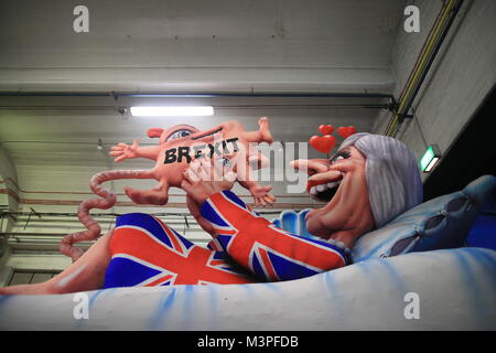 A political caricature float featuring 'Theresa May, prime minister of the United Kingdom' is prepared for the Rosenmontag - Stock Photo