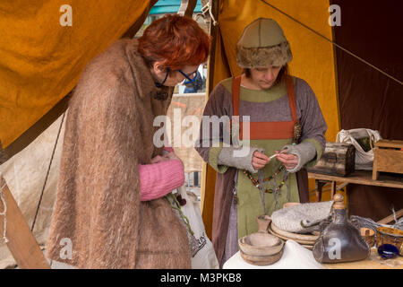 York, UK, 12th February 2018, Two women together, one dressed as a Viking, at the annual Jorvik Viking Festival. - Stock Photo