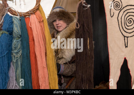 York, UK, 12th February 2018, Lady dressed as a Viking at the annual Jorvik Viking Festival. Standing by a market - Stock Photo